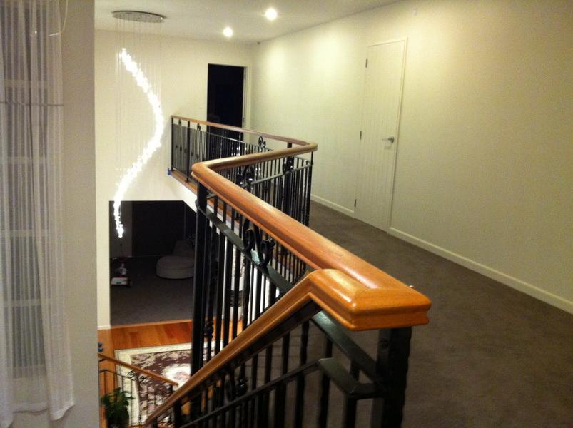 Curved Wooden Handrail on Wrought Iron Balustrade