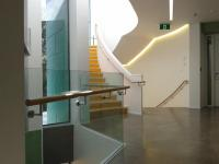 Round Wooden Handrail On Glass Balustrade