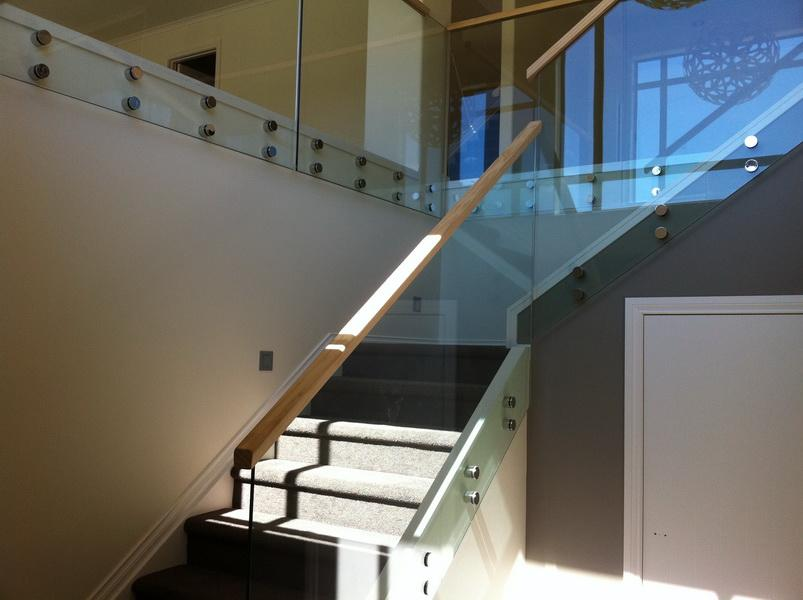 Wooden Handrail on Glass Balustrade